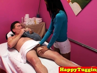 Dickriding asian masseuse gives on target handjob