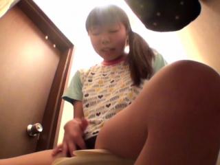 Asian tot rubs her vag