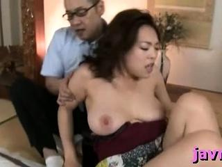 Chubby titted oriental milf rides hard penis vigorously