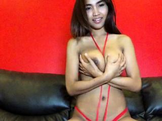 Big Soul Thai hottie strips red bikini